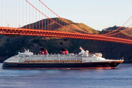 Disney Wonder cruise ship sails under the Golden Gate Bridge on the way to the Port of San Francisco